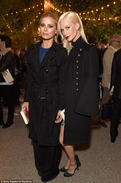Double trouble: Once inside, Poppy mingled with fellow model Laura Bailey