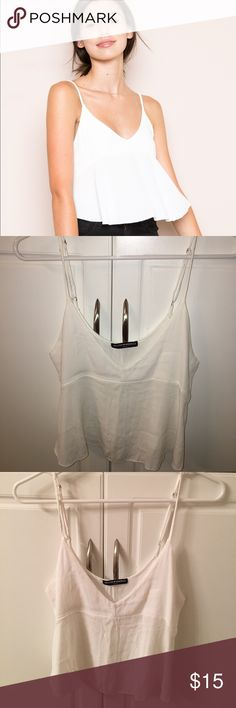 Brandy Melville Adalia White Crop Swing Tank For sale is the Brandy Melville Adalia Crop White Swing Tank in white- worn once, no stains, new condition Brandy Melville Tops Crop Tops