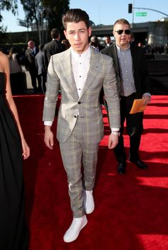 Nick Jonas looked sharp in a Versace suit with yellow plaid details and bright white sneakers on Feb. 8, 2015.