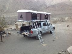 Two roof top tents installed on the same Toyota Tacoma truck.  www.bigfoottents.com