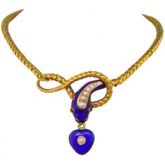 1880 Victorian snake necklace. An 18 Karat Yellow Gold, Natural Pearl, Ruby & Enamel Victorian Serpent Necklace