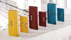 Tod's Women's Autumn Winter 2013-2014 Collection. Bright colors for these glossy small leather goods: wallets and credit card holders with distinctive Tod's metal accessory.
