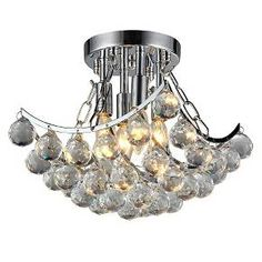 Make your home sparkle with light when you add this Warehouse Of Tiffany 11 X 11 X 16 Inch Silver Ceiling Light. With a shiny silver construction, this light includes four teardrop-shaped bulbs that bounce a beautiful glow off the several round crystals suspended from it. This gorgeous chandelier, which has a flush-mount design, instantly makes any space an elegant one. Hang this light fixture in your entryway or over your dining table.