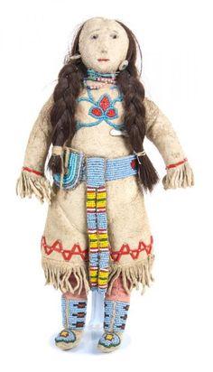 A Crow Beaded Doll