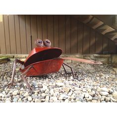 Cool metal art, this frog is made of two wheel barrows!