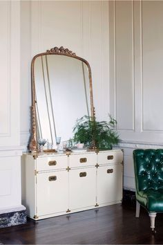 Eclectic design - Antique French mirror, mid century modern Campaign dresser, emerald green tufted chair