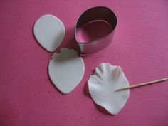 Use cheap circle cookie cutters, reshape, and use for peonies, roses, and calla lilies. Definitely cheaper than buying individual cutting sets.