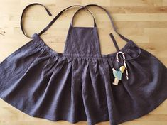 Linen pinafore/apron dress in one of the softest linens, a deep purple eggplant color Wear it over shorts or a skirt, or layer it over dresses or pants. Perfect for a little capsule wardrobe (Listing is for top layer pinafore dress only) Very adjustable straps for a flexible fit and