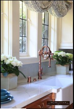 From Pasadena Showcase House 2017- This antique copper faucet is made by Water stone over a farm sink, provided by Ferguson.