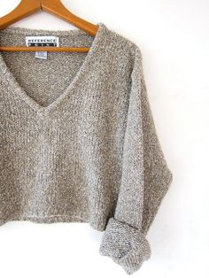 love this super cropped speckled oatmeal knit sweater with a plunging neckline. i cant get enough of how CUTE this is!!!! M E A S U R E M E N