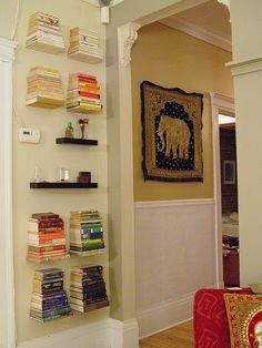 floating bookshelves, found them on amazon.com http://www.amazon.com/Umbra-Conceal-Invisable-Floating-Bookself/dp/B000UO4KXY/ref=dp_return_1?ie=UTF8&n;=284507&s;=kitchen.  And looooove the elephant tapestry on the wall :)