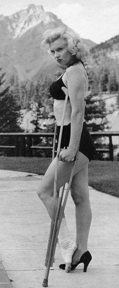 Marilyn. Photo by John Vachon, 1953. Even in a cast and on crutches, she looks stunning!! She makes crutches look sexy!