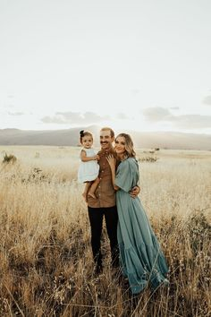 Beautiful, boho family photos in Arizona grass fields by Hillary Lacy Photography.