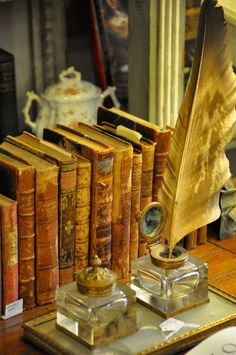 Vintage books and inkwells.* Doesn't this evoke reading a good book--especially one written by a friend. (-