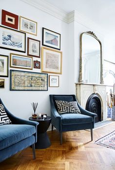 brooklyn tour decor gold mirror living room fireplace blue chair edwardian georgian victorian black white pillow gallery wall