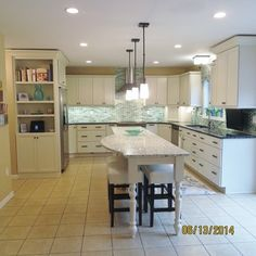 Kitchen remodel, what a difference an island makes! - Houzz - Notice in this photo the cabinet for the refrigerator. Also all drawers for storage which are SO much easier if they are full reveal style.