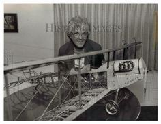 This is an original press photo. Carol Skinner of Springfield, president of the Oregon Aviation Museum, shows off a 1/6 scale model of a Curtiss JN-4 Jenny, used between 1914 and 1920 and one of the popular planes for the kind of self teaching required during the early days of Oregon aviation. Photo is dated 9-10-1989.