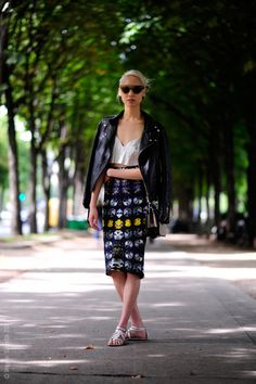 Soo Joo Park in a graphic print pencil skirt, cropped top, motorcycle jacket, sunglasses, and sandals.