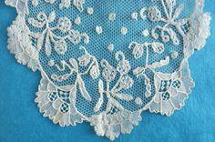 Brussels bobbin and needlelace applique on machine net