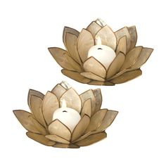 Showcasing a floral design and chic pearl finish, this eye-catching candleholder adds a touch of serenity to your living room or den.   ...