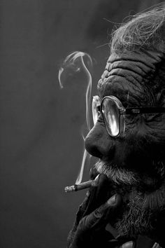 •Black & white photography man smoking