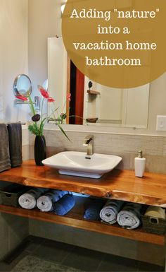 Way a fun way to create a relaxing feeling in a bathroom. I love how they cut, varnished and stained a bay laurel with it's live edge in tact as a bathroom vanity countertop. See other fun elements of this bathroom remodel by clicking through to this article. | Innovate Building Solutions