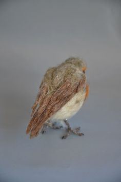The European Robin is handmade by the needle felt soft sculpture technique. I created this little unique wool sculpture out of natural, organic