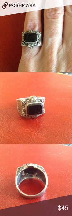 Vintage Silver Onyx Marcasite Ring 1980's Sterling silver ring. Elegant deco styling. Stately rectangular black onyx stone is surrounded by sparkly marcasites. Complete with the required patina of eighties going vintage. This beaut is small and works well as a pinky ring. Size 6.25. Weight 6g. Stamped 925. Missing one Marcasite stone (top left in 2nd pic). I did not notice it until the ring was under the scrutiny of the lens. This truly does not seem to impede its evening class and glamour…