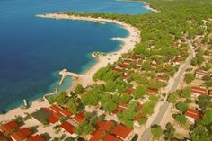 Enjoy our campsite Camping Village Simuni as a base for discovering the Dalmatian Coast of Croatia on a Eurocamp self catering holiday. Sicily Italy, Dalmatian, Campsite, Golf Courses, Places To Go, Coast, San, Beach, Water