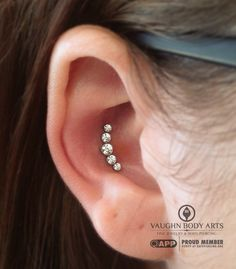 Brittany stopped in for a conch piercing. We had done a triple conch piercing on her a year ago, but sadly she had to take them out. So it was pretty nice to not only give her another conch piercing since she'd missed it so much, but to also put this gorgeous anatometal CZ cluster in. It looks perfect in her conch, thank you so much Brittany!