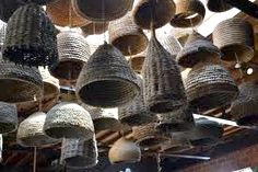 Antique skep hives using various shapes and found objects