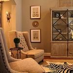 living rooms - Mythic Paint - Cane Pole - gray walls tufted wingback chairs directoire table layered jute rug gray washed cabinet