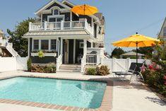 gray house - yellow door Beach Cottage Renovation - traditional - exterior - philadelphia - kelley gardner