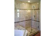 This Glass Shower door has:    Neo Angle Shower   Frameless Shower Doors   Brushed Nickel Finish   Low-Iron Glass   Mitered Tubular Handle   Zeus Style   Full Back Hinge   Sleeve Over Glass Clamp   Wall Mount Clamp
