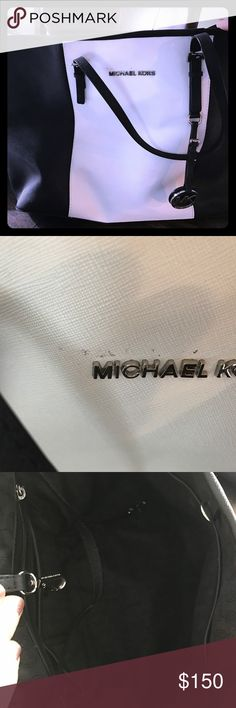 Michael Kors Large Leather Bag Jet Set Check pictures...there is some slight markings (it's like the backing of a sticker) on top of Michaels Kors emblem.  It's been gently used. No other signs of wear. Michael Kors Bags Totes