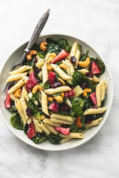 Sweet and tangy strawberry spinach pasta salad with orange poppyseed dressing is the perfect potluck side dish for every get together. | lecremedelacrumb.com