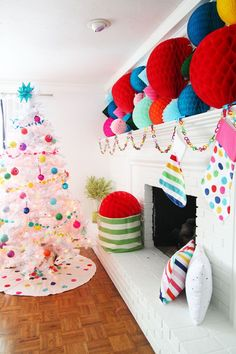 A happy burst of color against the backdrop of a white living room with a white Christmas tree. Colorful, kid friendly and happy for the holidays. see more at www.pencilshavingsstudio.com