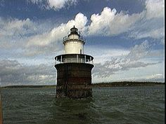 """Lubec Channel Light, built in 1890, is located on the west side of the Lubec Channel, Lubec, Maine. It is often referred to as the """"Spark Plug"""".  In 1989, the residents of Lubec, Maine and the Maine Historic Preservation Commission enabled this light to be restored. Rather than abandoning the tower and moving it to a shore location. Standing 53 feet above sea level, this light can be seen for 6 nautical miles."""