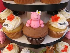 Barnyard Cupcake Tower   Inspired by the original farm animal cake and cupcakes , this tower was created to celebrate Hannah's first birthd...