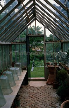 Inside, this greenhouse waits for its winter treasures