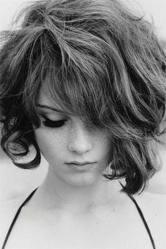 Beauty, freckles, asymmetrical hair style