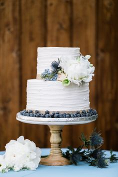blueberry and gold wedding cake
