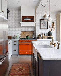 Toms kitchen  a bold pop of colour in our director Toms London kitchen . . . #lacanche #orange #colourpop #interiordesign #tomhouse #haminteriors #designinspo #kitchendesign #waterworks #reclaimedmaterials #kitchenstyle #marble