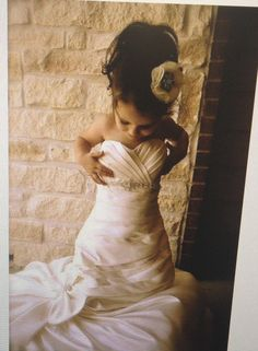 A need a picture of Payton with her hair done flower crown on and ready for the wedding playing in my dress.. NEED!!