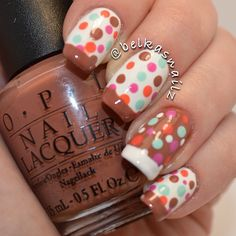 Bright multi-color dots on white with brown tips nail art design