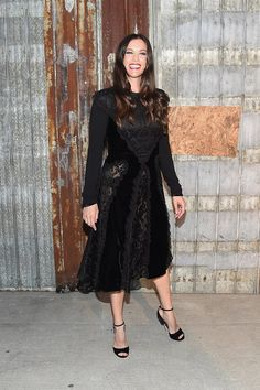 Pin for Later: These Stars Have Been Sitting Pretty in NYFW's Front Row Liv Tyler Liv smiled wide in a lacy mid-length black dress.