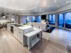 gorgeous white open concept family room, kitchen and dining