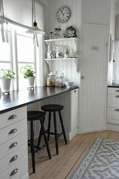 Bead board, corner cabinet, windows down to counter top, wide floorboards, and countertops look like something we could make.