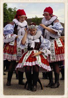 Europe | Portrait of three young women wearing traditnal clothes, Czech Republic