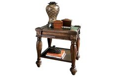 "The Mantera End Table from Ashley Furniture HomeStore (AFHS.com). The Old World design accented beautifully with traditional European influences brings the rich style of the ""Mantera"" accent table collection to life."